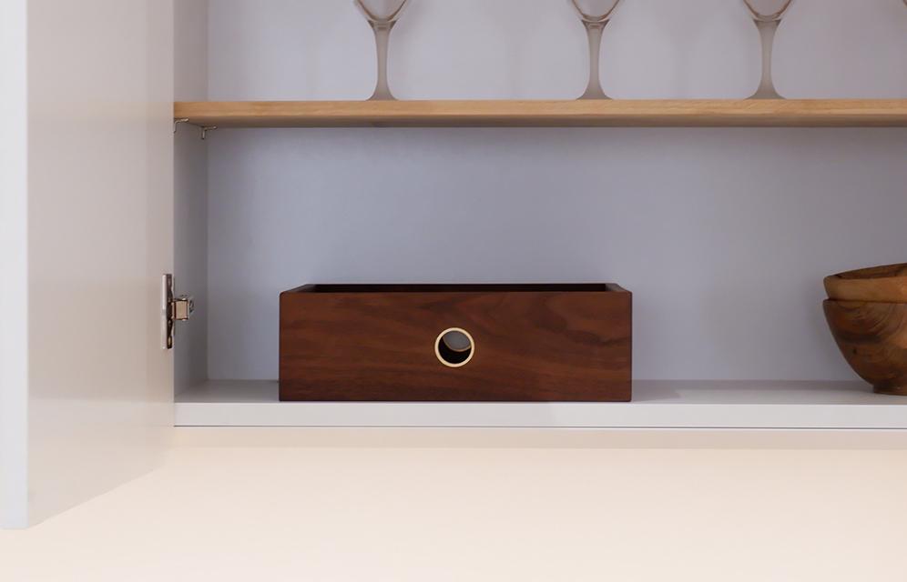 american walnut storage crate in a cupboard