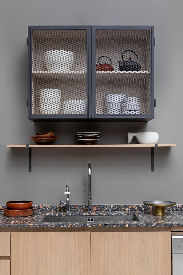 Bespoke kitchen design with a steel checkered cabinet